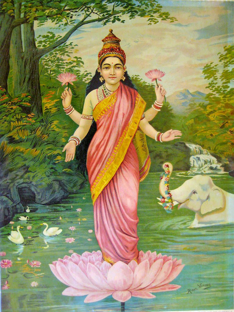 The Hindu goddess Lakshmi of prosperity with pink lotuses in two of her four hands, in standing on a lotus in a river.