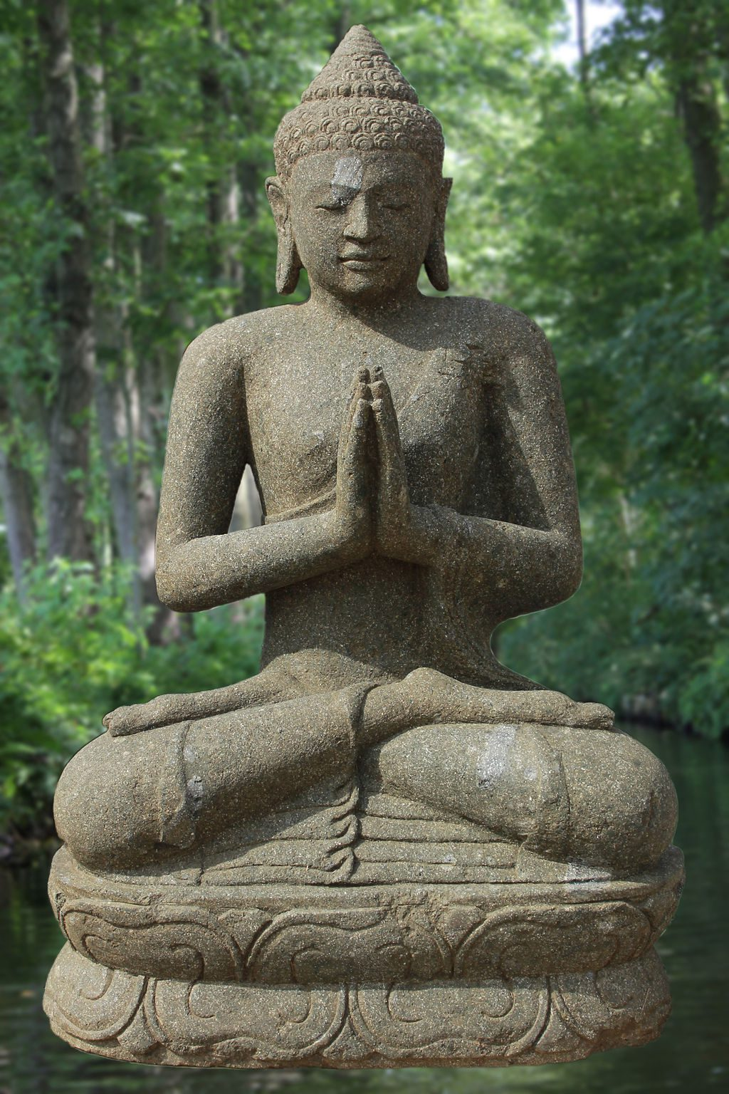 stone statue of a Buddha with hands in prayer or anjali mudra position