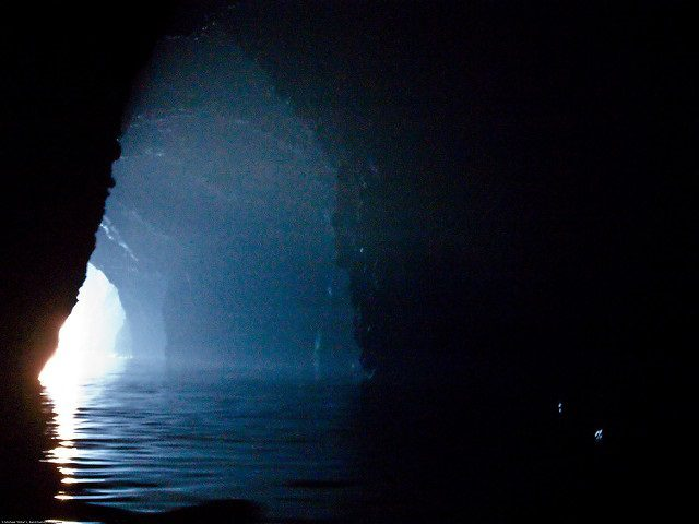 Try acting as if there is no material world: ocean cave with light streaming through