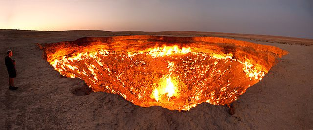 The Door to Hell, a burning natural gas field in Derweze, Turkmenistan. It´s actually bigger than it looks. Three 17 mm shots stitched together.  Image:     Tormod Sandtorv (original picture)    Hellbus (derived work).